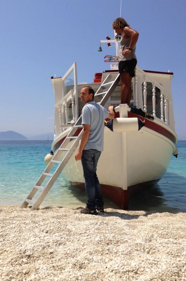 The ferryman waits in vain for people leaving Agiofili beach